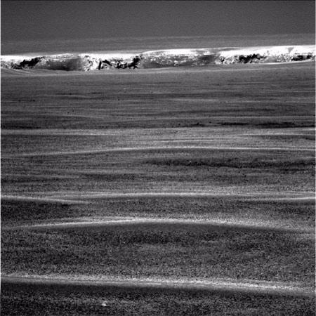 The Opportunity rover approaches the rim of Victoria Crater, which it has been driving towards for more than a year