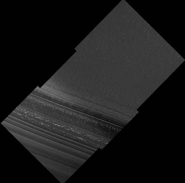 Layered deposits of ice and dust appear in this image showing terrain near Mars's north pole. Bright flecks are probably patches of water ice frost on the surface