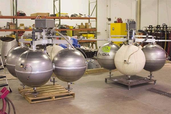 Armadillo Aerospace is the frontrunner for the prize – their Pixel and Texel vehicles use four spherical fuel tanks placed around a central engine