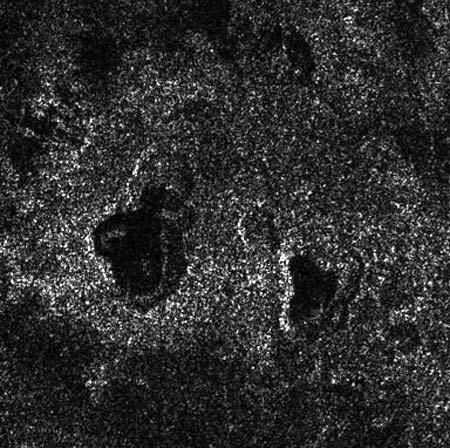 The nested structure of the two lakes at centre in this Titan radar image suggests that they are the sites of repeated collapse. This may have occured after volcanic water slush spewed from underground, leaving the overlying material without support