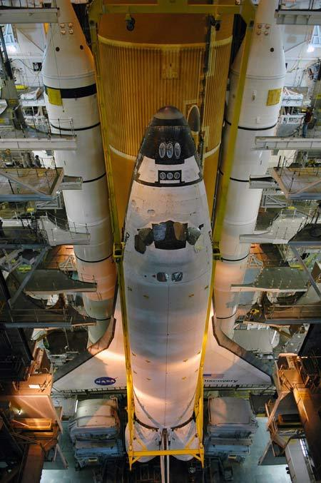 The shuttle Discovery is being prepared for a December launch in the Vehicle Assembly Building at Florida's Kennedy Space Center