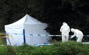 Forensic officers at the scene of a suspicious death