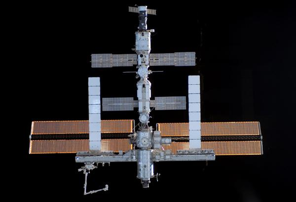 Crew members will toss things from the 'rear' of the International Space Station so they will not hit the station, according to the new policy. This image was taken from the shuttle Atlantis in September 2006, before it docked with the ISS