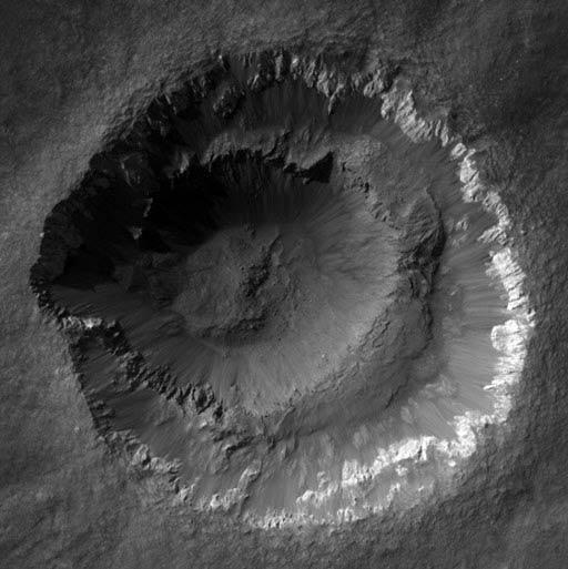 Ada Crater is puzzling because it has features indicating it is very young, yet its rim is as eroded as those of much older craters. It also has a strange double rim, whose origin is unknown
