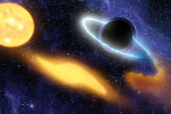 The gravity of a black hole about 10 times as massive as the one at the centre of the Milky Way rips apart a star that wanders too close to it (left), stretching it out into a blob (centre) and swallowing pieces of it over the course of several years. As the pieces swirl into the black hole, they are heated to hundreds of thousands of degrees, creating a flare that shines at ultraviolet and X-ray wavelengths (Illustration: NASA/JPL-Caltech/Tim Pyle/SSC)