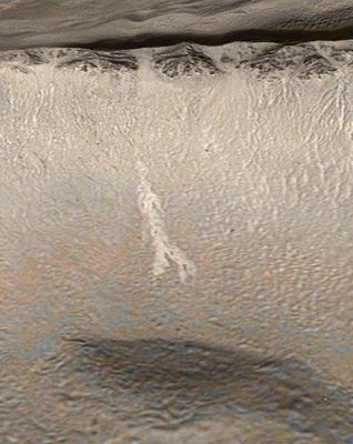 A zoomed in view shows another gully recently filled with light-coloured material
