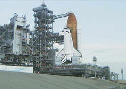 The space shuttle Discovery sits on Pad 39B at Kennedy Space Center waiting for its Thursday ride to space