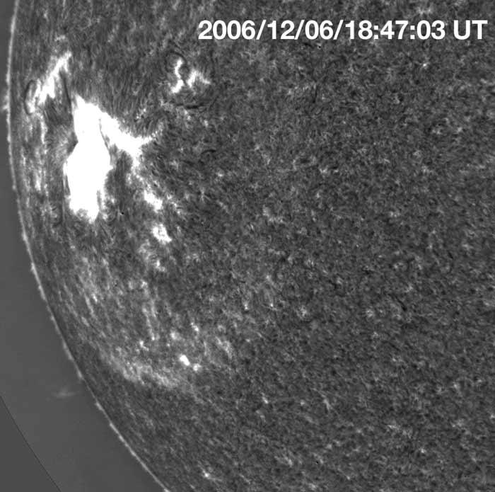 An expanding blast wave appears as a broad, bright ring surrounding the blotchy white flare seen near the left-hand edge of the Sun