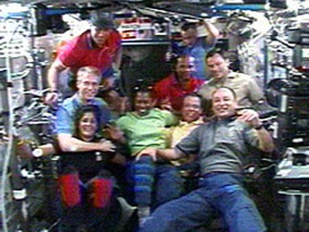 Members of the station and shuttle crews pose for a group picture in the Destiny laboratory shortly after the hatches between the two vehicles were opened