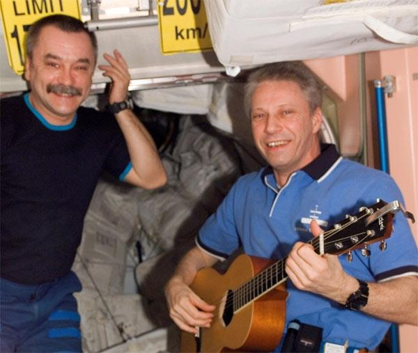 ESA astronaut Thomas Reiter (right) entertains cosmonaut Mikhail Tyurin and the other astronauts on day 7 of Discovery's mission to the ISS