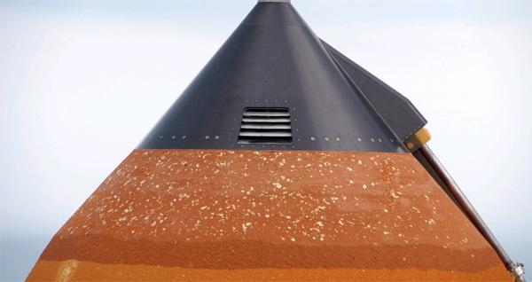 Hail caused damage all the way around the top of the external fuel tank of the space shuttle Atlantis
