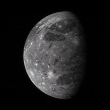 The granddaddy of solar system satellites, Ganymede, shows off old dark material as well as brighter young terrain and bright pockmarks left over from meteoroid impacts