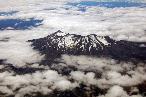 Ruapehu is one of the world's most active volcanoes. The deep crater lies between its peaks and fills with a lake between big eruptions