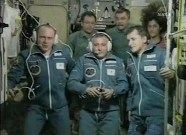 The incoming and outgoing crews of the ISS gather to speak with Russian space dignitaries after the Soyuz docking