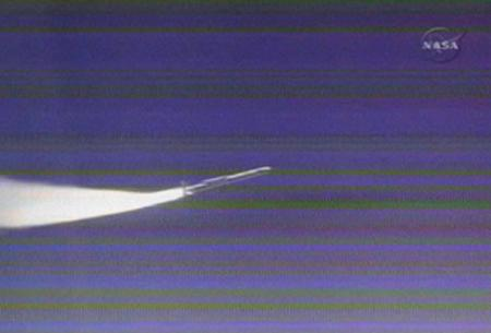 A Pegasus rocket ignites, carrying the AIM spacecraft to orbit