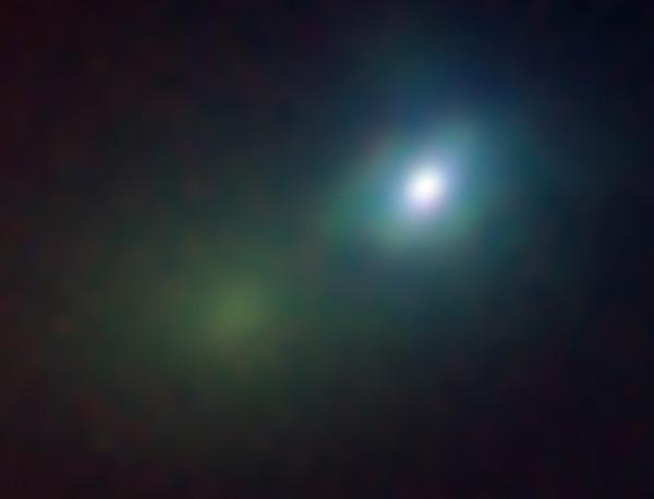 SN 2006gy appears as a bright white object on the right in this Lick Observatory image, while the core of the host galaxy appears greenish at left
