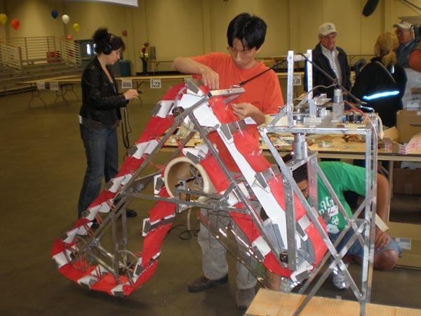Masafumi Iai, a student at the University of Missouri at Rolla, makes adjustments to the Lunar Miner, his team's entry in the competition