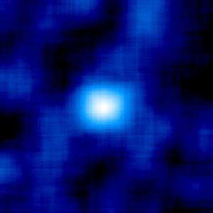The Willman 1 galaxy was discovered in 2004 hidden behind a dense field of stars in our own galaxy. This image from the Sloan Digital Sky Survey has been processed to highlight Willman 1 (white blob) amongst the foreground stars