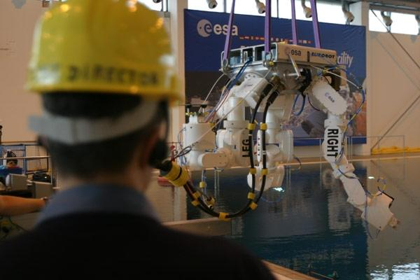 Eurobot is lowered into a water tank for tests at the European Astronaut Centre in Cologne, Germany