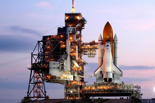 The space shuttle Endeavour sits on launch pad 39A at sunrise