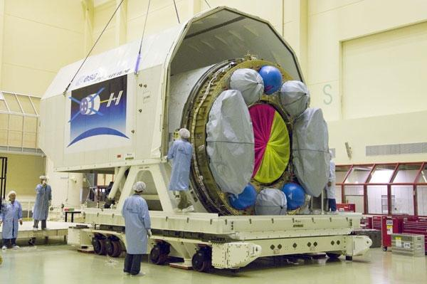 A piece of the Jules Verne cargo ship is placed in a container ahead of its journey to Kourou, French Guiana