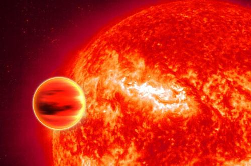 The Spitzer Space Telescope has detected water vapour in the atmosphere of the gas giant planet HD189733b (Illustration: Christophe Carreau/ESA)