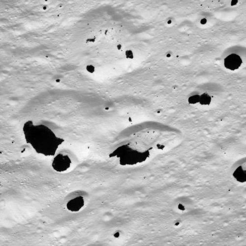 Terrain in the transition region between the moon's dark leading hemisphere and its bright trailing hemisphere is mottled like a Dalmatian dog