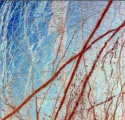 Ice covers Jupiter's moon Europa in this false-colour image, where bluish areas are icy plains and darker regions show 'dirty' ice. A liquid water ocean is thought to exist below the ice