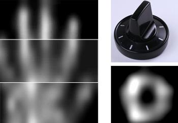 The prototype screen can capture crude images of anything near its surface – in this case a human hand and a plastic dial