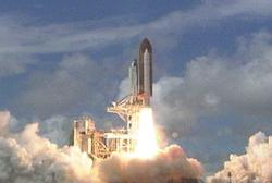 Shuttle Discovery launches carrying a new hub for the space station
