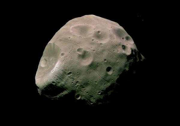 This image of Phobos, taken by Europe's Mars Express spacecraft from a distance of less than 200 km, shows the Mars-facing side of the moon