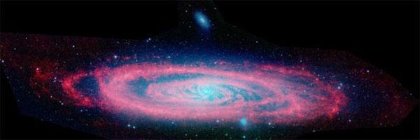 A galaxy as massive as the Andromeda galaxy, seen here in ultraviolet and infrared light, could be lurking behind a veil of dust at the centre of the Milky Way. If it is there and we could see through the dust, the galaxy would appear larger than the Full Moon