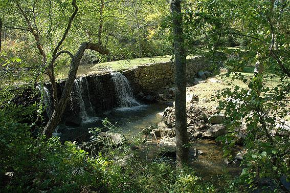 A milldam on Pickering Creek in Chester County, Pennsylvania. The dam spans the entire valley, and is filled to the brim with sediment