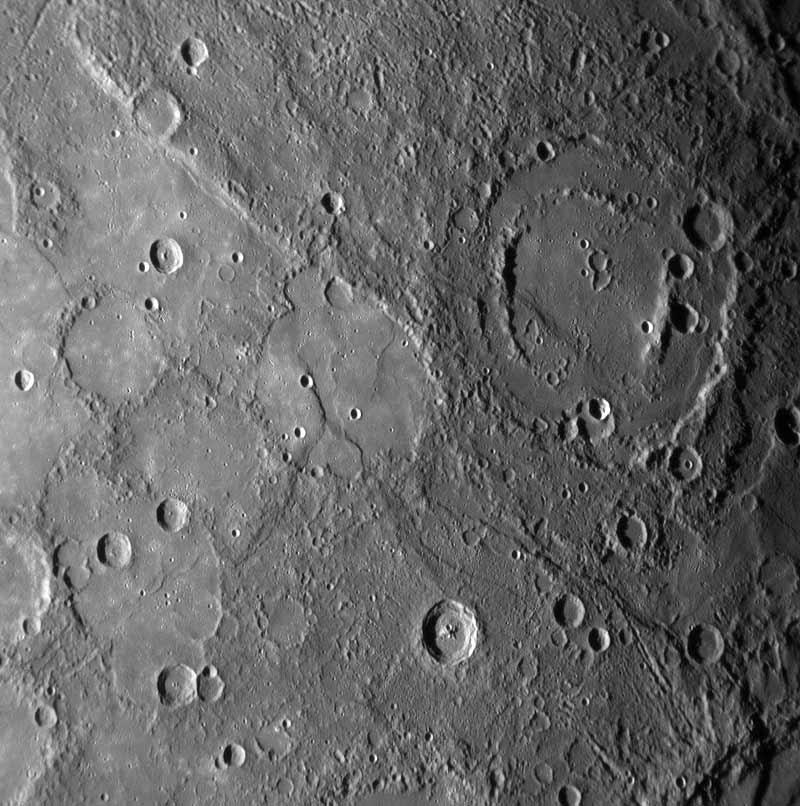 Sharp cliffs and escarpments visible on the close-up images may indicate that the whole planet shrank as it cooled