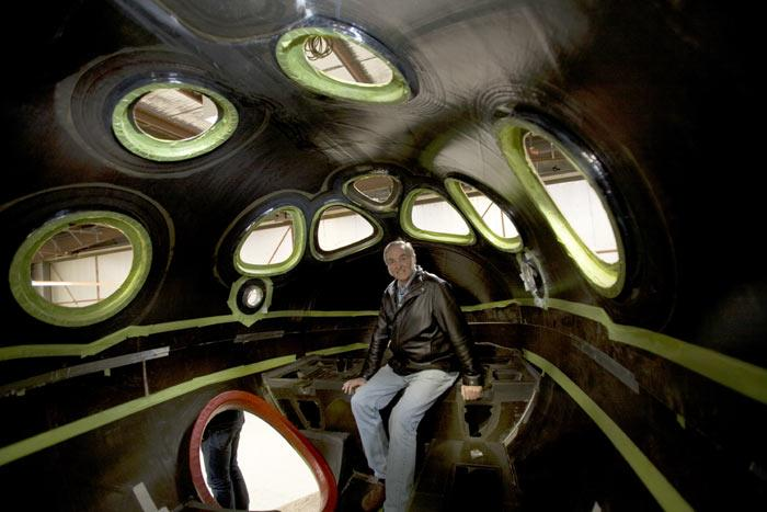 Spacecraft designer Burt Rutan sits inside a model of SpaceShipTwo's cabin