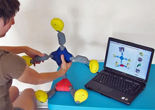The high-tech construction kit can sense its position and makes a 3D virtual double. Physical additions or adjustments are immediately reproduced on-screen