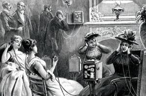 Illustration of men and women testing the Theatrophone at a hotel in Paris. The Theatrophone offered subscribers entertainment such as live theater performances