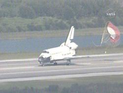 The shuttle Atlantis lands at Florida's Kennedy Space Center after a 13-day mission
