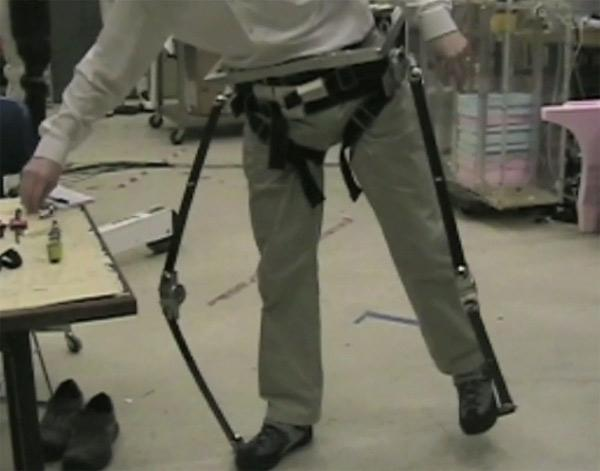 A fibreglass exoskeleton helps simulate what it is like to walk on the Moon in a pressurised space suit