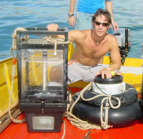 Team member Steve Simpson with the light trap and sound system used to collect larval fish as they return to reefs. The larval fish preferred the traps broadcasting noises made by invertebrate food sources
