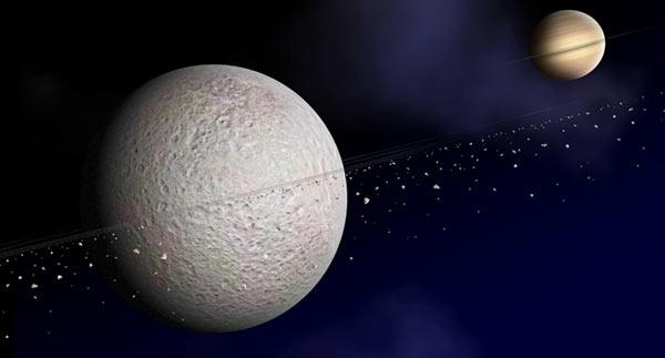 Telltale drops in electron flow measured by the Cassini spacecraft suggest Saturn's 1500-kilometre moon Rhea has rings made of debris ranging from pebble to boulder size (Illustration: NASA/JPL/JHUAPL)