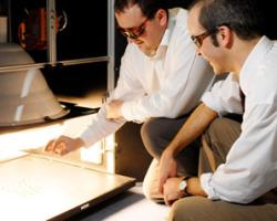 Dr Dave Worsley (right) and Dr Trystan Watson of Swansea University, investigating the efficiency of new solar cells