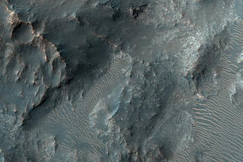 Holden Crater, a section of which is shown in this HiRISE image, was home to a lake at two times in its history