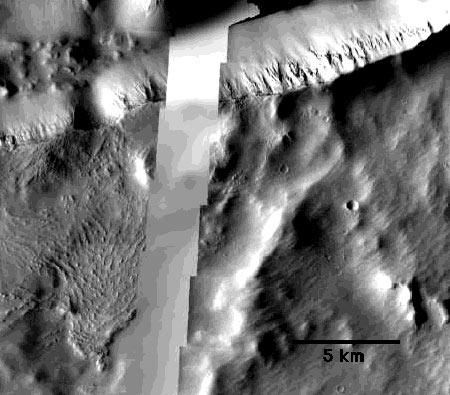 On the left side of this image from NASA's Mars Odyssey spacecraft, rock formations show ridges parallel to what was once probably a mud flow in Mars's Cerberus Fossae region