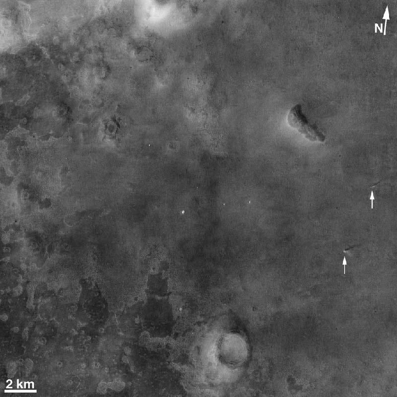 The Context Camera on NASA's Mars Reconnaissance Orbiter captured this image of two dust devils (marked with arrows) on 20 April