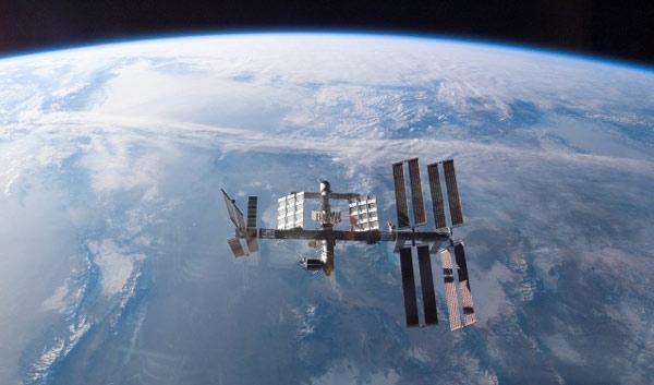 The space station zips around Earth at about 30,000 kilometres per hour, remaining visible to an observer on the ground for about 5 minutes during each pass