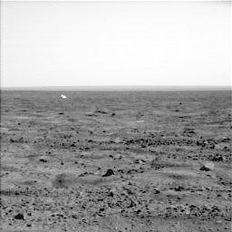 The white object in the distance is the lander's backshell