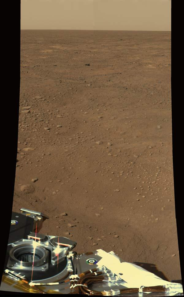 Phoenix took this colour image on Tuesday showing part of the lander against the Martian landscape