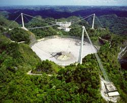 The Arecibo telescope in Puerto Rico bounces radio waves off of asteroids