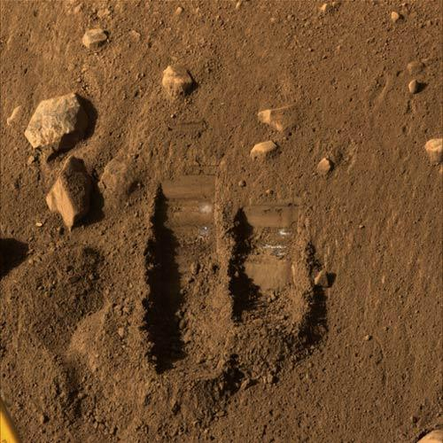 Phoenix created the trench at left, called 'Dodo', during practice digs; it dug up soil from the trench at right, dubbed 'Baby Bear', to put into its TEGA instrument